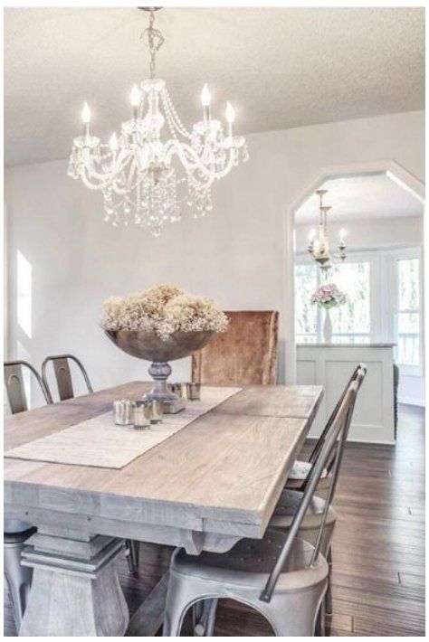 Shabby chic dining room with chandelier and faded furniture