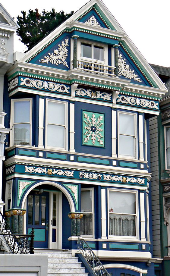 Modern Victorian home exterior with blue color and unique pattern