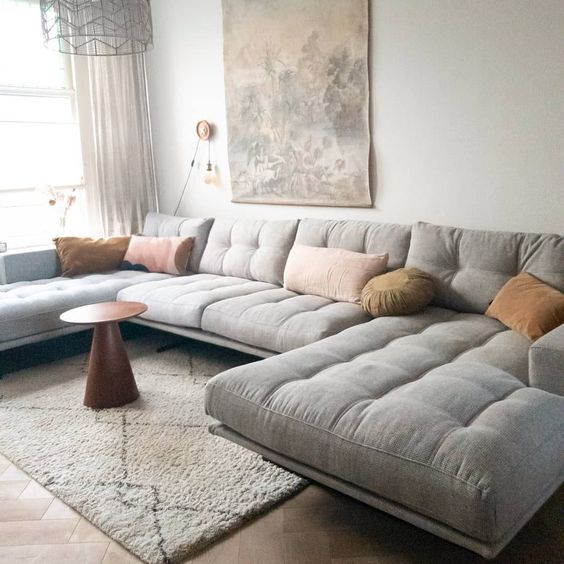 Sectional sofa in cozy eclectic living room