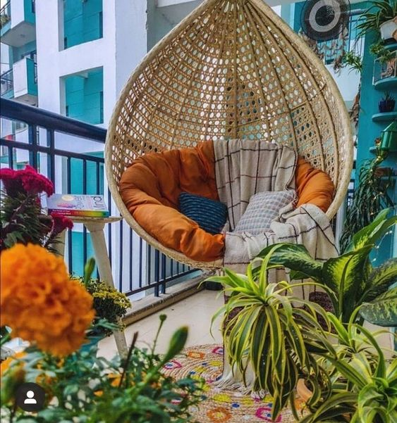 Hanging chair in eclectic balcony