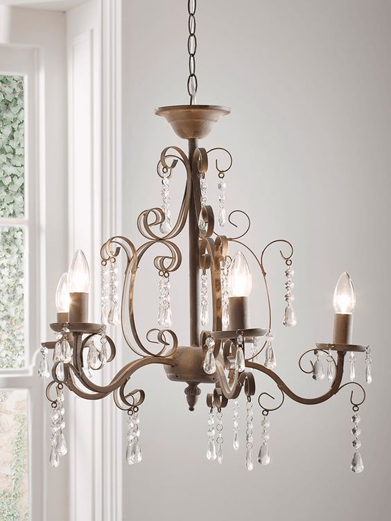Modern Victorian style chandelier with yellow light