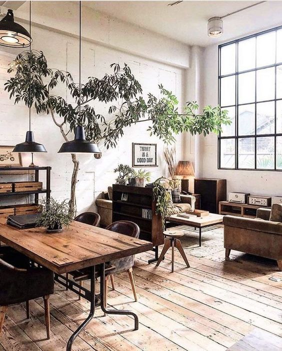 Wooden furniture and flooring in the small rustic living room