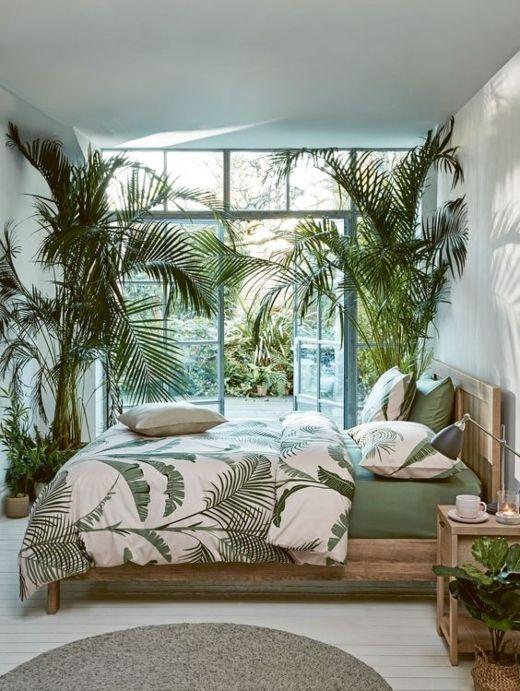 A big window in a tropical bedroom