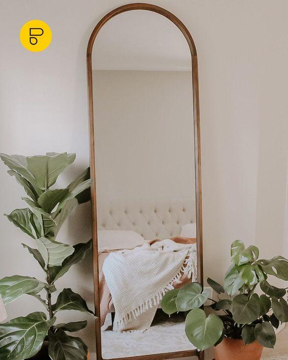 A gold long mirror