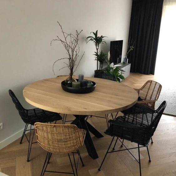 Round wooden table with rattan dining chairs industrial style
