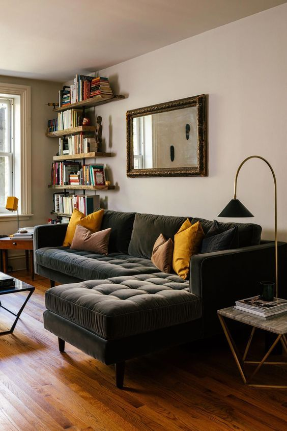 Industrial living room looks elegant with a black sofa