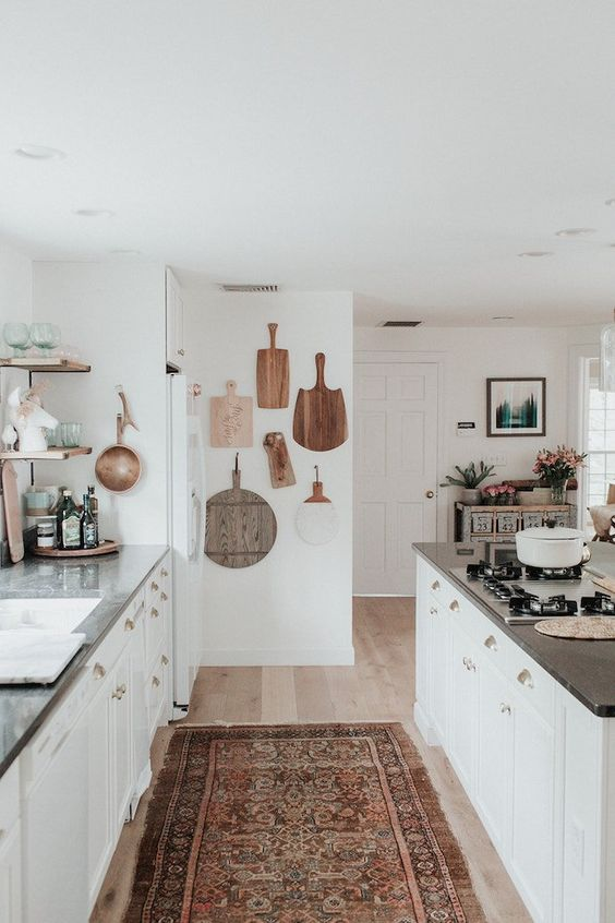 White small bohemian kitchen with cutting board