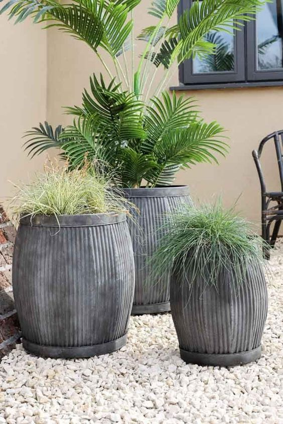 Light grey stone outdoor plant pot