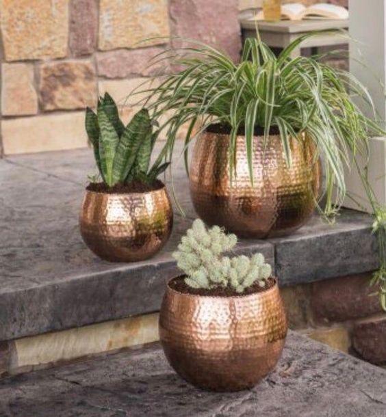 Shiny gold outdoor plant pot