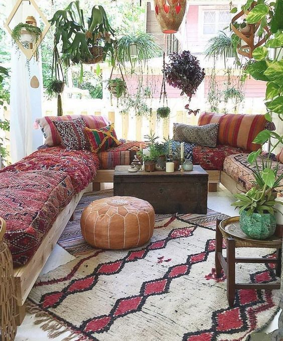 Maroon sofa and some hanging plants